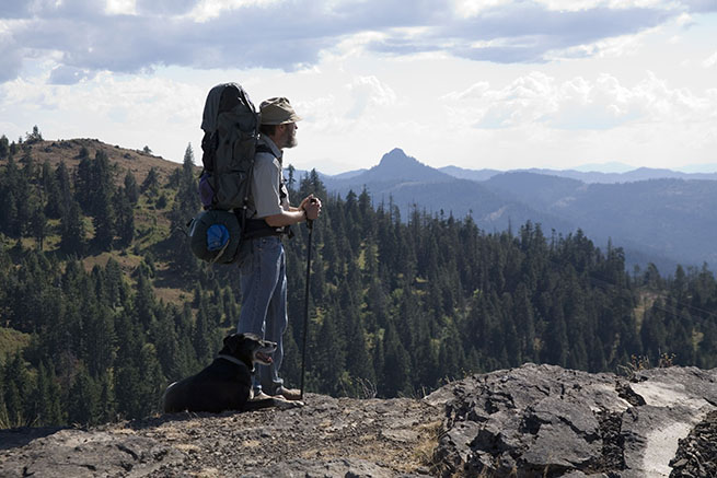 A hiker and his dog on the Pacific Crest Trail