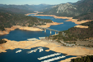 Aerial view of of I-5 Pit River Bridge over Lake Shasta showing low water level (drought conditions)